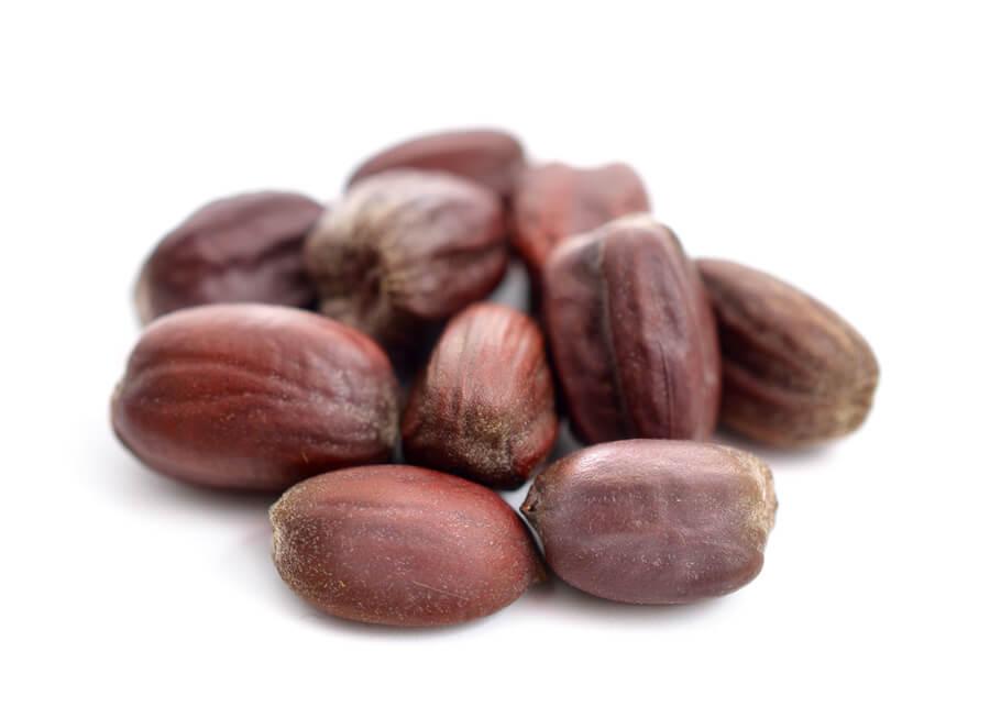 A pile of jojoba seeds