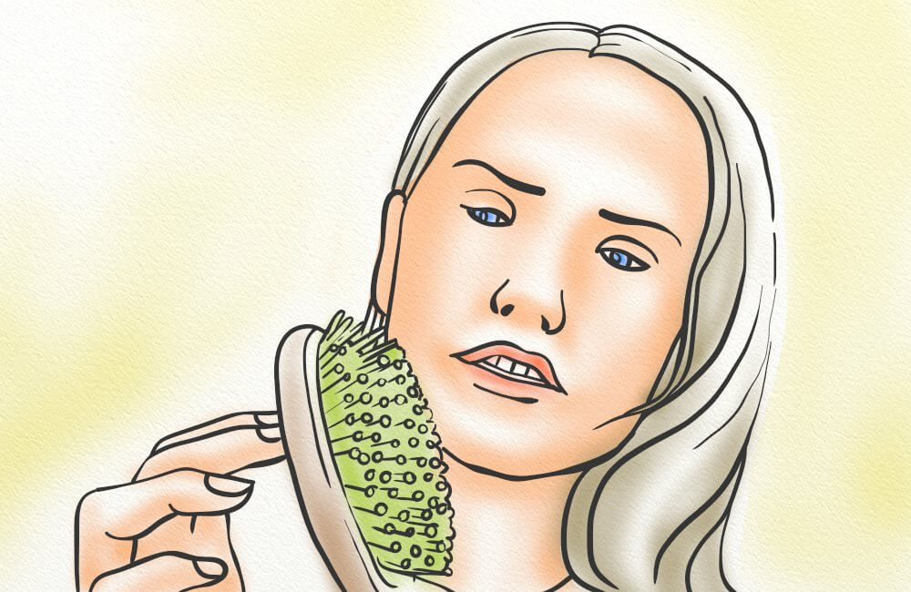 A woman noticing shed hairs in your brush