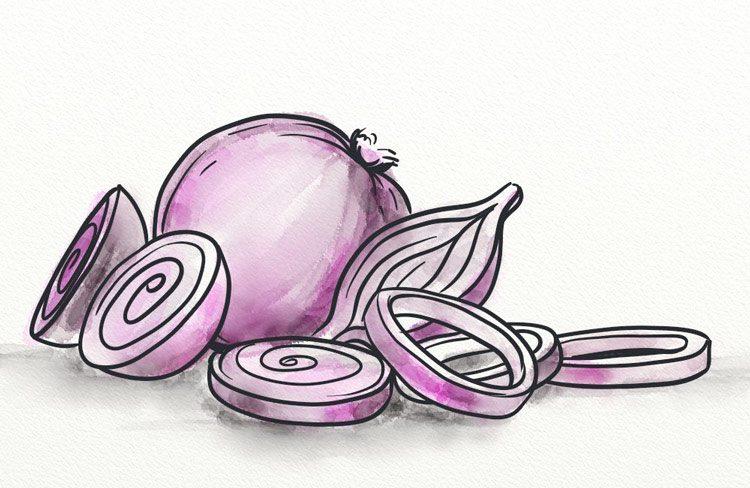Chopped onions next to a whole onion