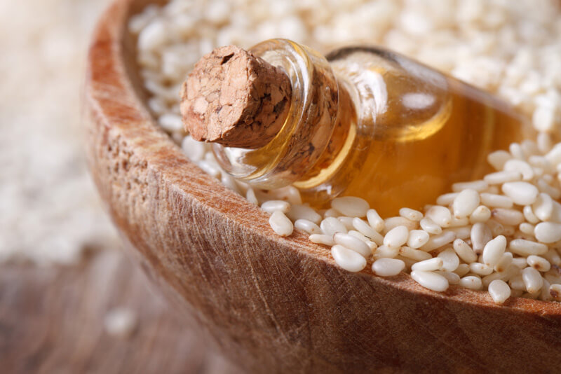 Sesame oil in a bowl of sesame seeds